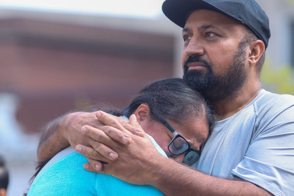 <p>Ramandeep Chochan cries into the chest of a loved one Sunday at Monument Circle in Indianapolis. Family members of victims killed in a mass shooting Thursday said that thoughts and prayers are not enough and demanded action going forward.</p>