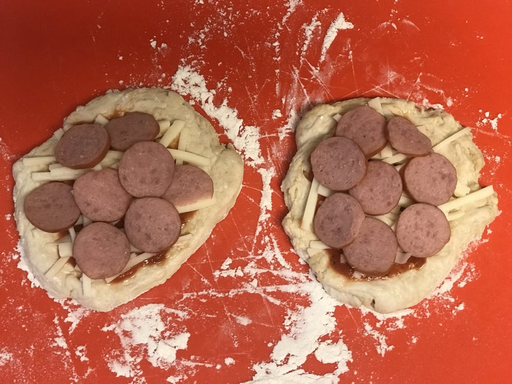 Bradley's uncooked pizzas sit ready for the oven. He replaced the traditional pepperoni with a turkey Kielbasa.