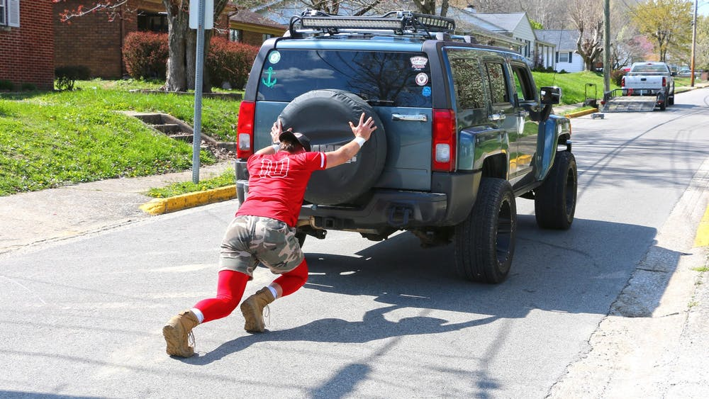Freshman pitcher AJ Hacker pushes a car while training from home. IU athletes have been forced to find new ways of training away from the weight room as a result of COVID-19.