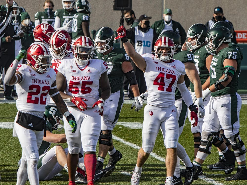 The-junior linebacker Micah McFadden puts his fist in the air during the first quarter against Michigan State Nov. 14 in Spartan Stadium in East Lansing, Michigan. IU was one of eight schools to have two players represented on the All-American team.
