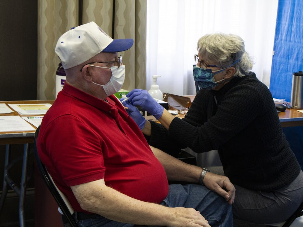 Nurse Cathy Green gives Raymond Lamar their second dose of the Moderna COVID-19 vaccine Feb. 24 at the Monroe Convention Center. Monroe County Health Department administrator Penny Caudill said the clinic distributes about 800 doses a week.