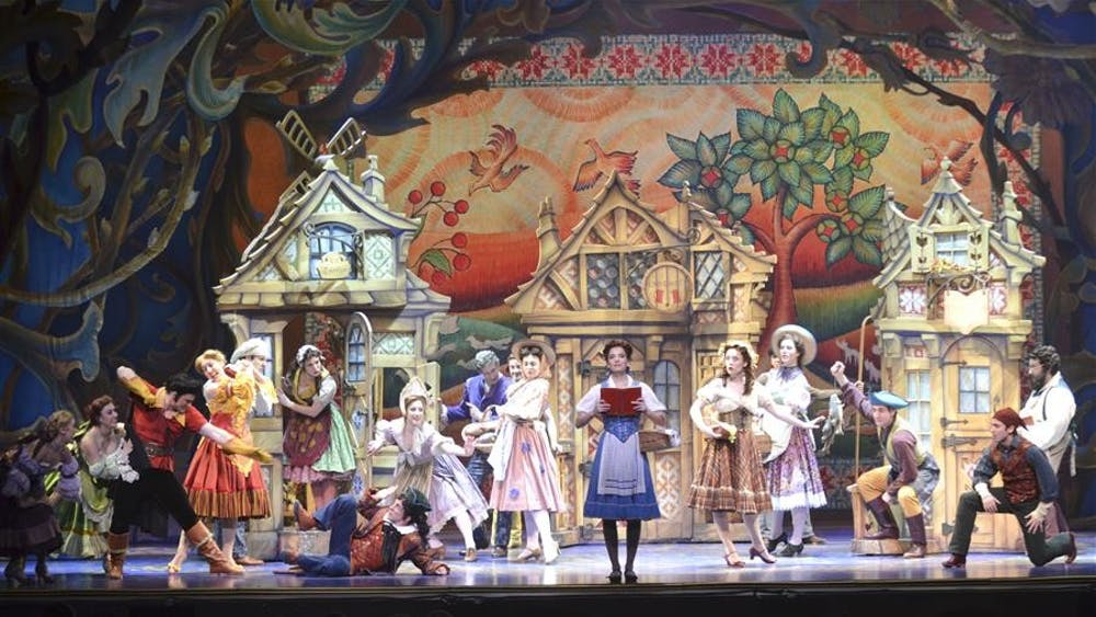 """Cast members sing during Act I of Disney's """"Beauty and The Beast"""" performance at the IU Auditorium on Thursday night."""