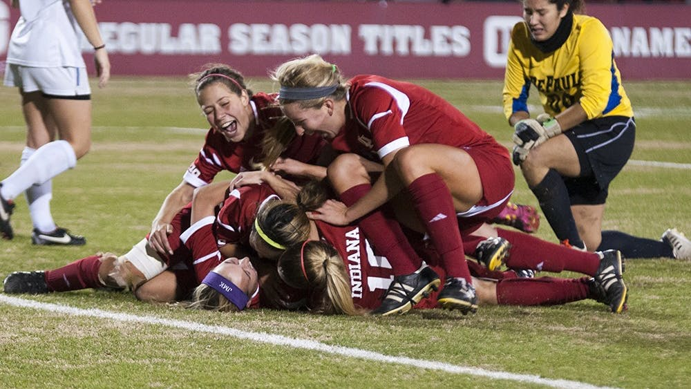 Members of the IU Women's Soccer team piles onto then-freshman Veronica Ellis after scoring the game winning goal against DePaul on Nov. 16, 2013 at Bill Armstrong Stadium.