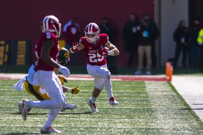Senior wide receiver Luke Timian runs down the sideline during IU's 42-16 loss to Iowa on Oct. 13 at Memorial Stadium. The Hoosiers worsened to 4-2 on the season after the loss.