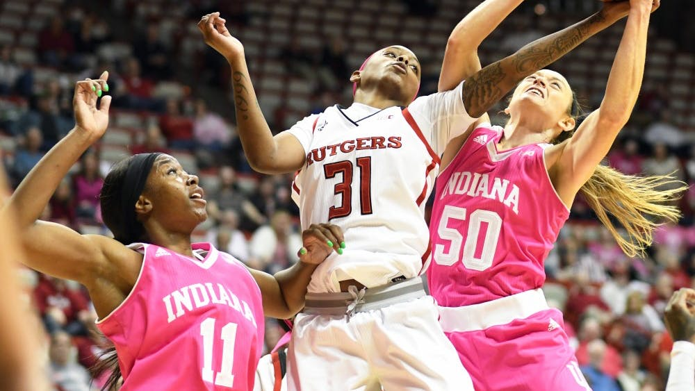 Junior forward Brenna Wise goes up for a rebound Feb. 18 during the game against Rutgers in Simon Skjodt Assembly Hall. IU lost to Rutgers, 69-61.