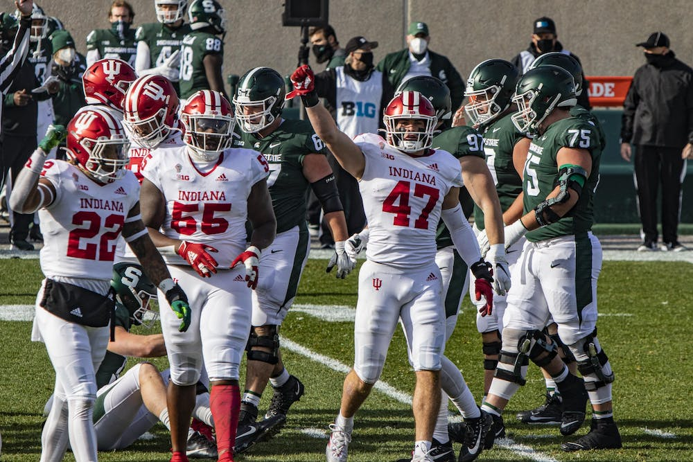 <p>Junior linebacker Micah McFadden puts his fist in the air in the first quarter against Michigan State on Nov. 14 in Spartan Stadium in East Lansing, Michigan. No. 9 IU is scheduled to play No. 3 Ohio State on Saturday, with the winner likely favored to win the Big Ten east division.</p>