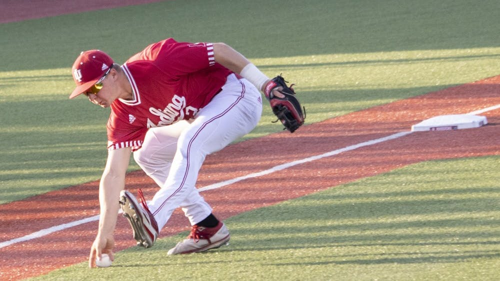 Sophomore infielder Cole Barr reaches for the ball May 14 at Bart Kaufman Field. Barr fielded the ball near the third base line to send it to first base against the University of Louisville.