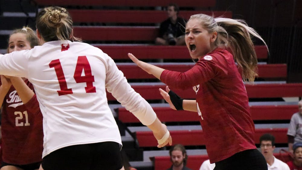 IU junior Bayli Lebo and her teammates celebrate a point Sept. 6 at Wilkinson Hall against Oregon State University. The Hoosiers beat Yale University 3-1 Sunday.