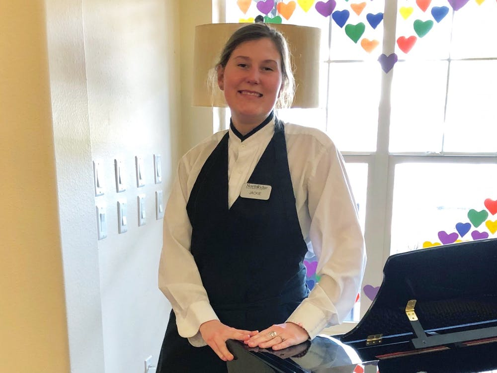 Jaclyn Klinger, a server at Northridge Gracious Retirement Living, poses for a photo. Klinger has temporarily moved into the facility due to the coronavirus pandemic.