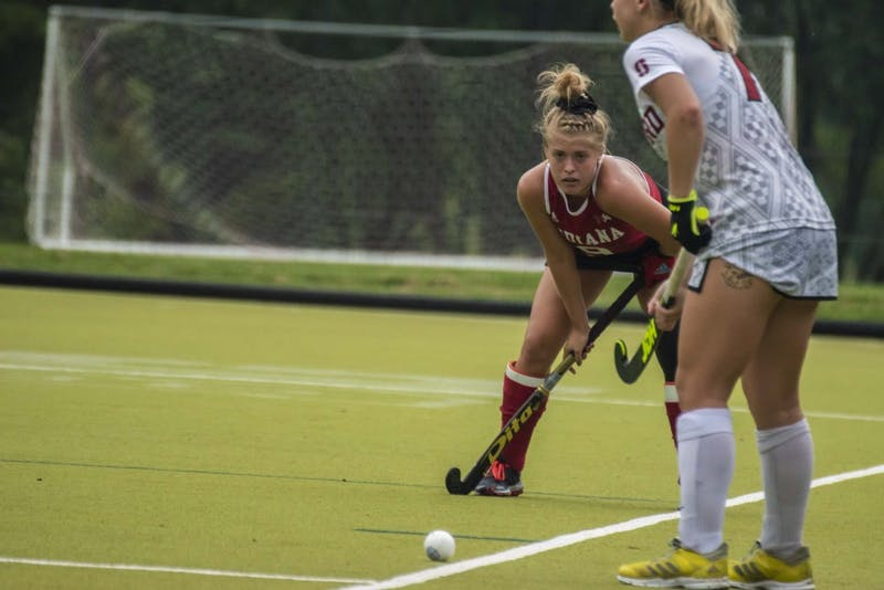 Senior Claire Woods eyes the ball during the Sept. 7 game against Stanford at the IU Field Hockey Complex. Woods scored a goal, but IU lost to Michigan State in the first round of the Big Ten Tournament.