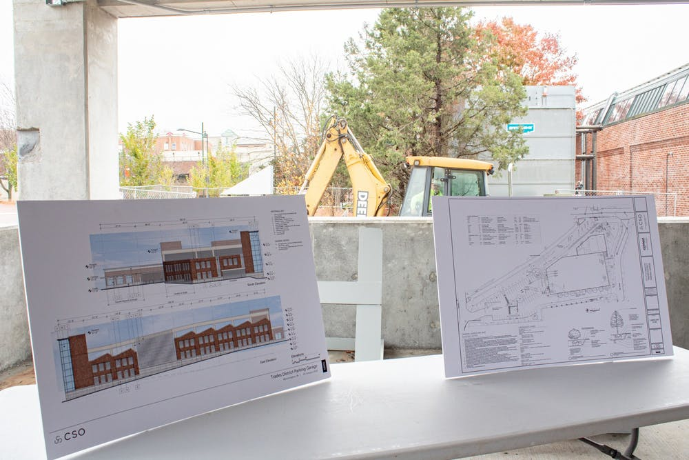 Drawings and designs of the Trades District Parking Garage are shown in the garage.