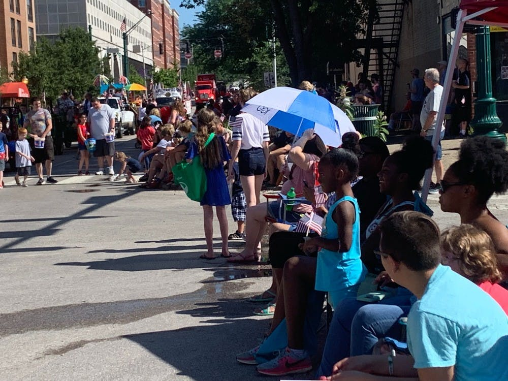<p>People gather outside the Monroe County Courthouse July 4 to watch the annual Fourth of July parade. Parade participants handed out stickers, bracelets, toys, water and candy to children.<strong><br/></strong><br/></p>
