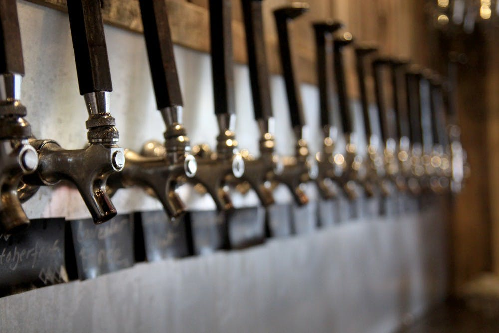 <p>Beer taps line the wall behind the bar at Switchyard Brewing Company. The brewery is owned by Kurtis Cummings and Jeff Hall.&nbsp;</p>