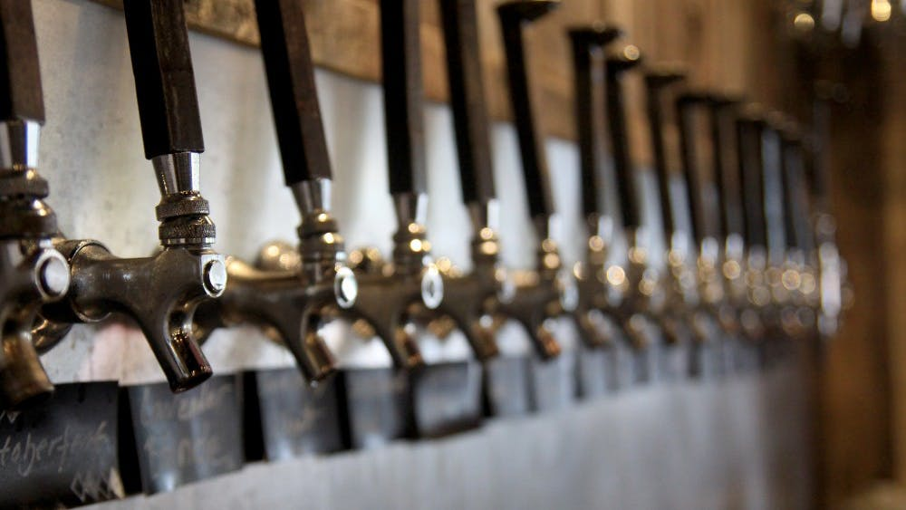 Beer taps line the wall behind the bar at Switchyard Brewing Company. The brewery is owned by Kurtis Cummings and Jeff Hall.