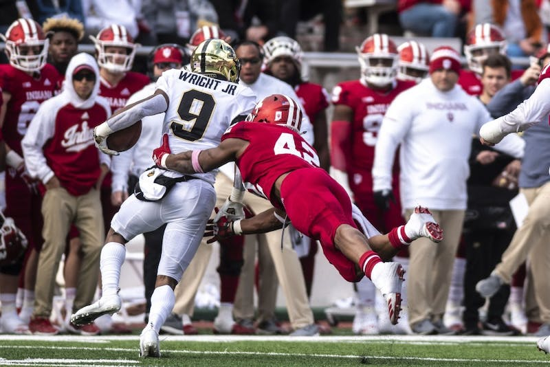 Sophomore defensive back Marcelino Ball makes a tackle on Purdue's Terry Wright Jr. on Nov. 24 at Memorial Stadium. Purdue won the game, 28-21.
