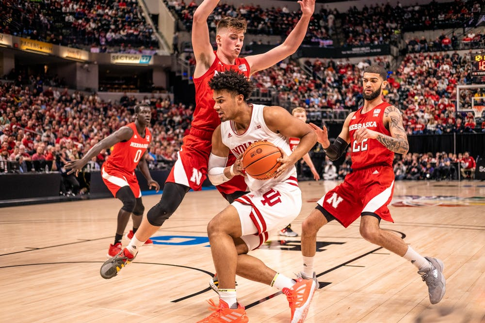 <p>Junior forward Justin Smith gains control of the ball as a Nebraska player tries to block him. IU defeated Nebraska in the Big Ten Tournament on March 11 at Bankers Life Fieldhouse in Indianapolis.</p>