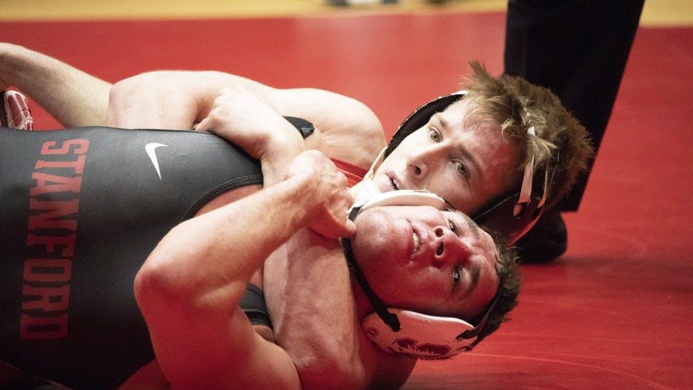 Redshirt senior Bryce Martin pins a Stanford University wrestler Feb. 9 in Wilkinson Hall. IU battled against No. 25 Stanford and won, 31-7.