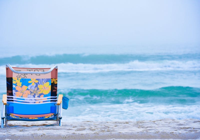 A beach chair rests on the sand. Travelers can expect a different experience than pre-coronavirus pandemic travel, according to Becky Liu-Lastres, IUPUI assistant professor of Tourism, Event and Sport Management, and Evan Jordan, IU assistant professor in the Department of Recreation, Park and Tourism Studies.