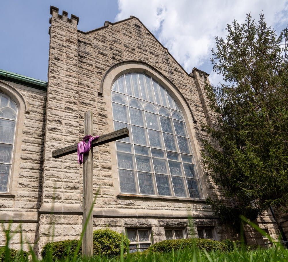 <p>A cross stands April 7 in from of First United Methodist Church in Bloomington.</p>