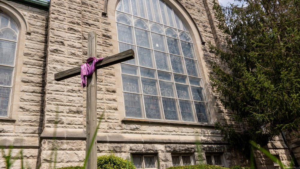 A cross stands April 7 in from of First United Methodist Church in Bloomington.