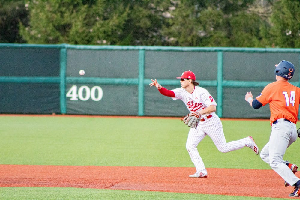 <p>Freshman infielder Paul Toetz throws the ball to second base April 10 at Bart Kaufman Field. The IU baseball team will play a three-game series against Minnesota this weekend at home. </p>