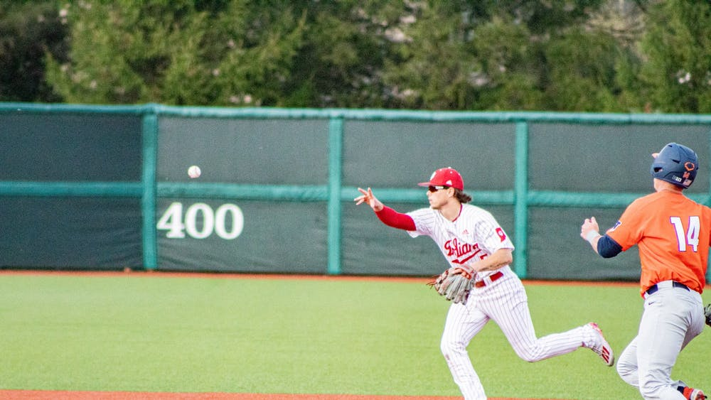 Freshman infielder Paul Toetz throws the ball to second base April 10 at Bart Kaufman Field. The IU baseball team will play a three-game series against Minnesota this weekend at home.