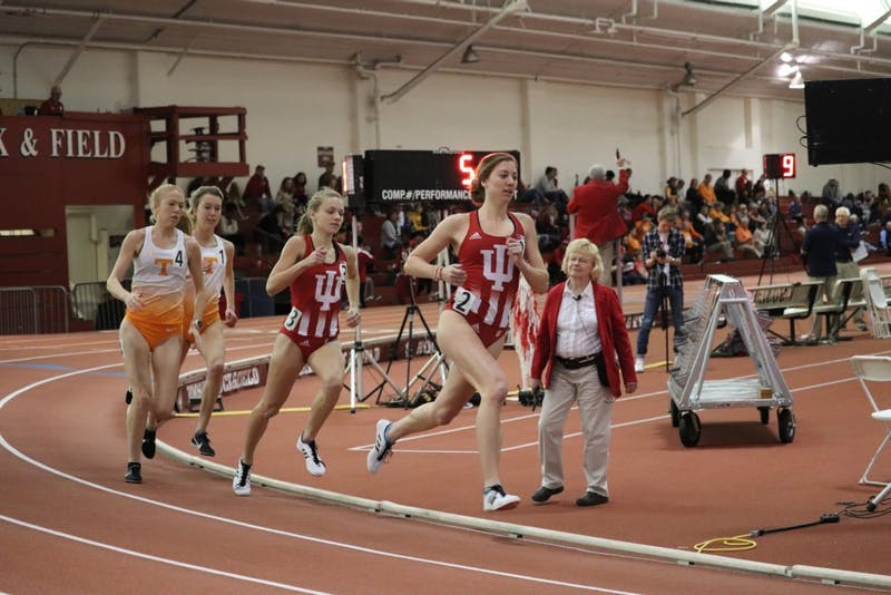 Distance runners Kelsey Harris and Jenna Barker lead the pack against University of Tennessee on Jan. 5 in Gladstein Fieldhouse.
