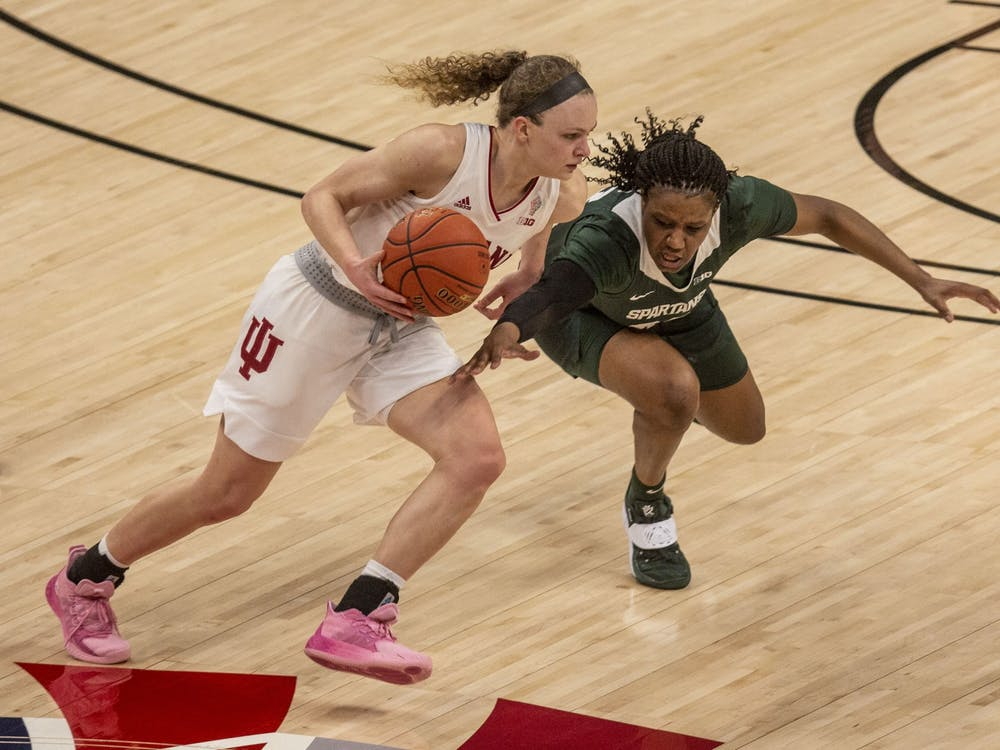 Junior guard Grace Berger dribbles around a defender March 11 in the quarterfinals of the Big Ten women's basketball tournament at Bankers Life Fieldhouse in Indianapolis. Berger was IU's leading scorer in a 70-48 win over Belmont University on Wednesday.