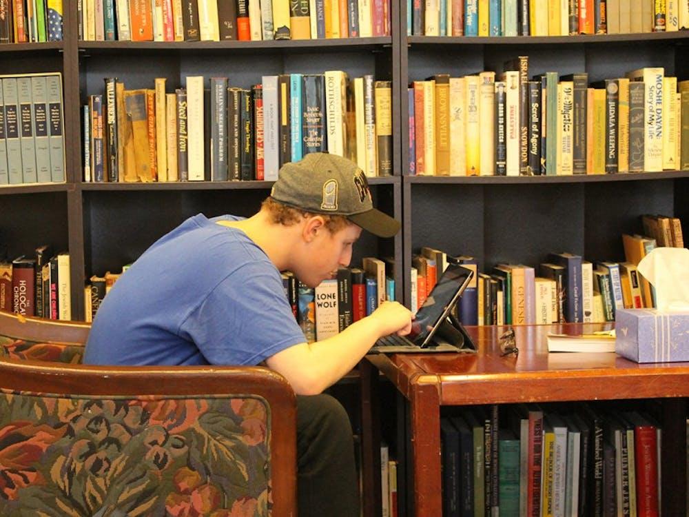 SophomoreJordan Schiff, surrounded by Jewish literature,studies inthe Helene G. Simon Hillel Center on campus.