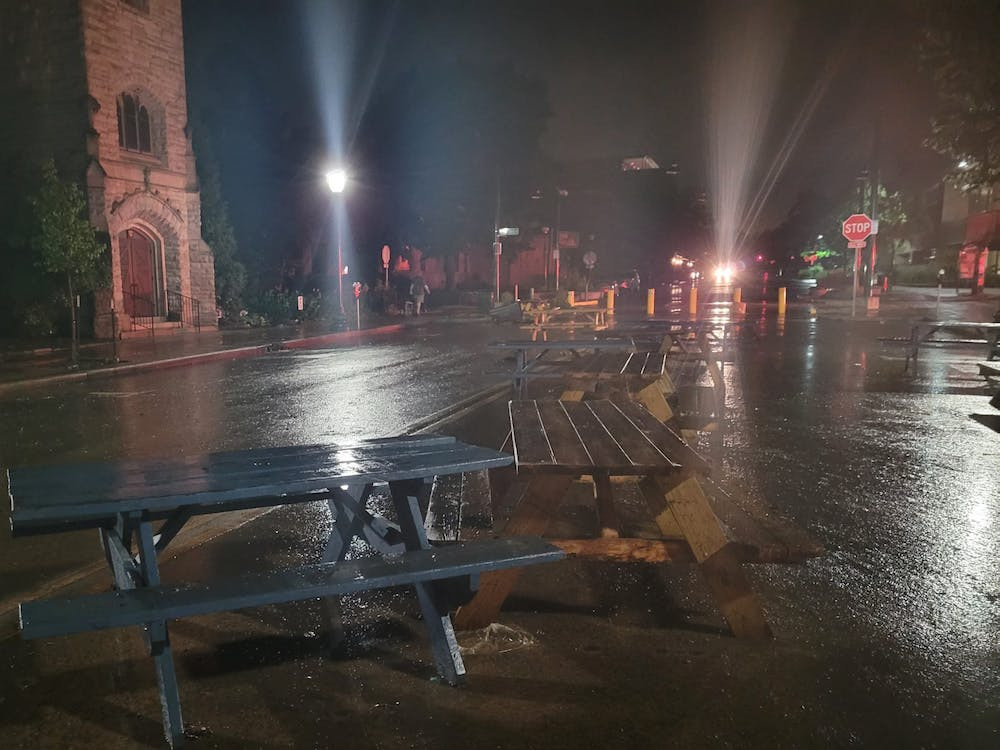 Picnic tables lie on Kirkwood Ave in Bloomington after being displaced by floodwaters Friday night. Bloomington Fire Department Deputy Chief Jayme Washel spoke with the Indiana Daily Student about flood safety Saturday.