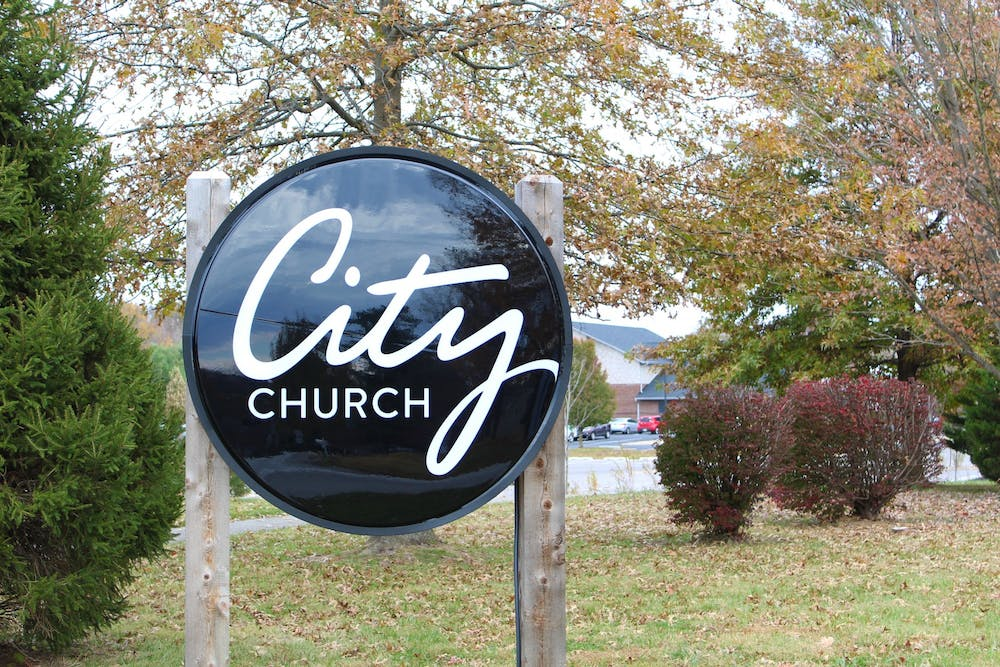 <p>A sign stands in front of City Church For All Nations on Nov. 6 on Russell Road. The church is working with a charity to help erase more than $2 million in medical debt in Bloomington. </p>