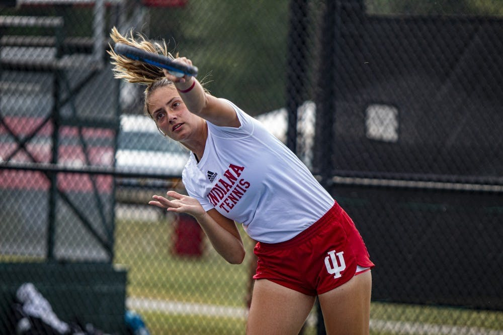 <p>Then-freshman tennis player Mila Mejic finishes her serve Sept. 29, 2019 at the IU Hoosier Classic. Mejic came to IU from Subotica, Serbia, to continue playing tennis while getting an education</p>