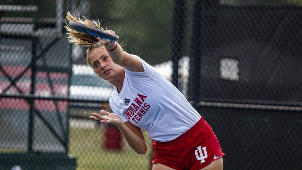 Then-freshman tennis player Mila Mejic finishes her serve Sept. 29, 2019 at the IU Hoosier Classic. Mejic came to IU from Subotica, Serbia, to continue playing tennis while getting an education