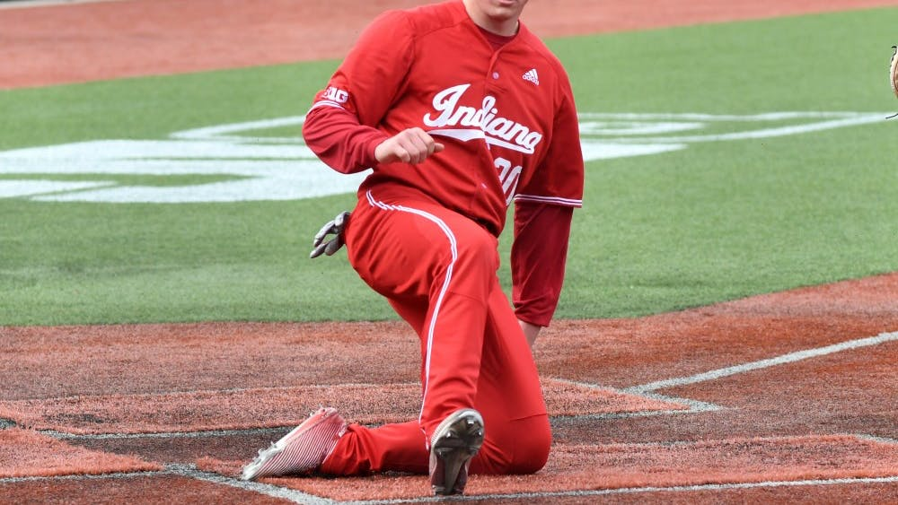 Sophomore infielder Scotty Bradley slides into home plate against Purdue on April 8 at Bart Kaufman Field. The Hoosiers are currently predicted as a three seed in the most recent postseason projections.