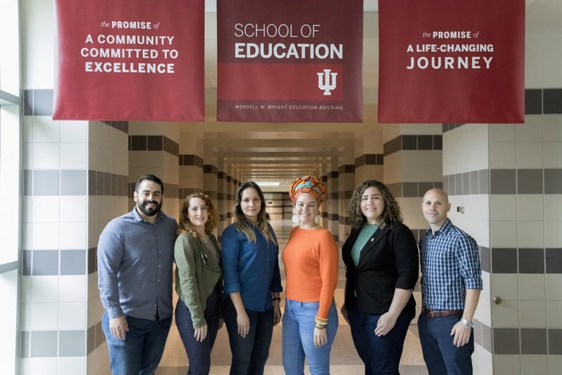 Six scholars from the University of Puerto Rico stand in the School of Education on Wednesday, April 25. The IU Bloomington-Universidad de Puerto Rico Education Graduate Scholars program created space for six graduate education students from the University of Puerto Rico to work and study at IU-Bloomington.