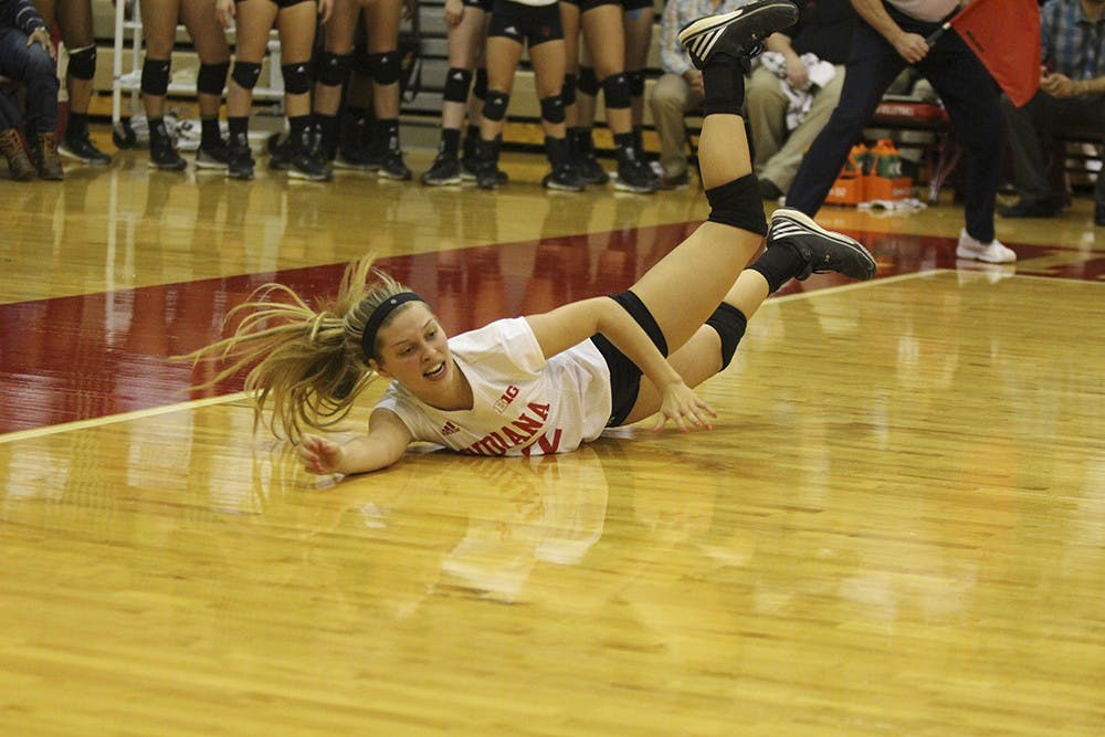 Freshman defensive specialist Samantha Fogg dives for the ball during the game against Nebraska on Nov. 7 at the University Gym. The Hooisers lost 3 games to 0.