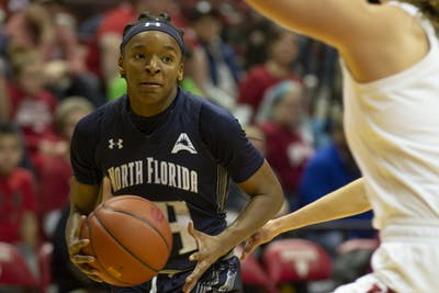 The University of North Florida's Janesha Green looks for an open player Dec. 7 at Simon Skjodt Assembly Hall. Green scored a team high 13 points in North Florida's loss to No. 14 IU.