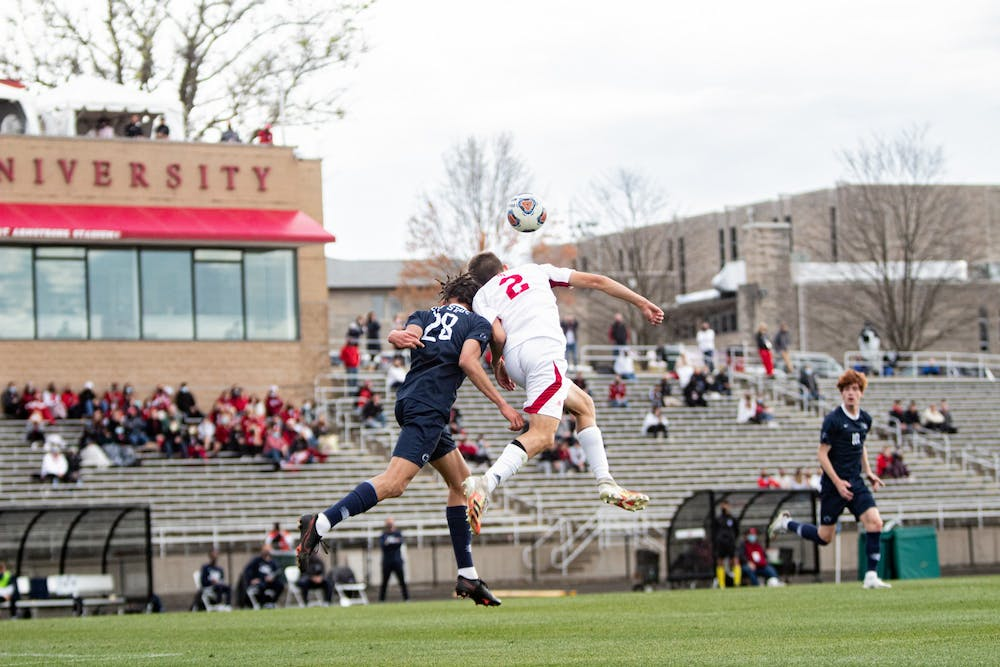 <p>Freshman defender Joey Maher heads the ball April 17 at Bill Armstrong Stadium. Indiana won 3-1 Sunday in penalty kicks during a game against St. Francis Brooklyn.</p>