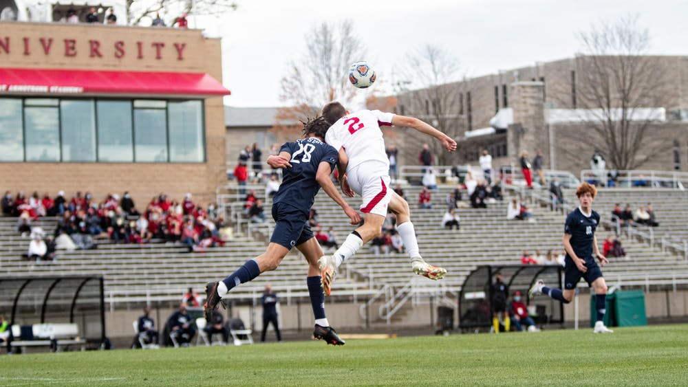 Freshman defender Joey Maher heads the ball April 17 at Bill Armstrong Stadium. Indiana won 3-1 Sunday in penalty kicks during a game against St. Francis Brooklyn.