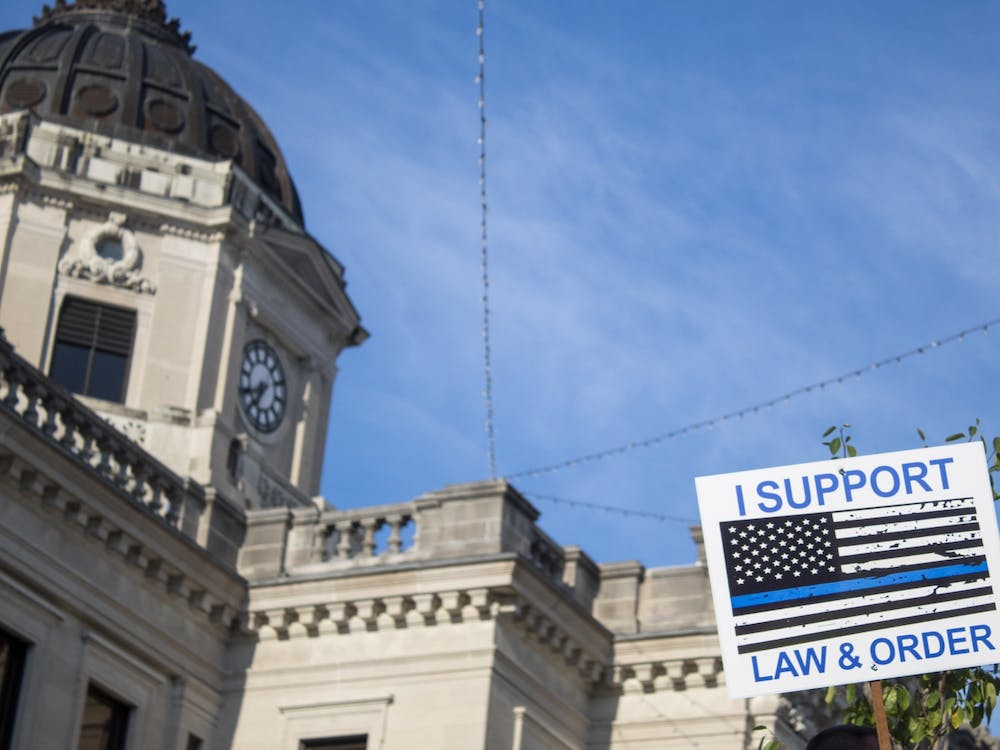 """A sign reading """"I support law & order"""" is held up Aug. 22 in front of the Monroe County Courthouse. During the protest there were several altercations between pro-police and Black Lives Matter groups."""