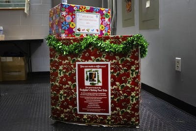 Two donation boxes sit on the floor Dec. 8 at the Bloomington Fire Department. The BFD is accepting non-perishable food donations and winter clothing donations at all stations until Dec. 16.