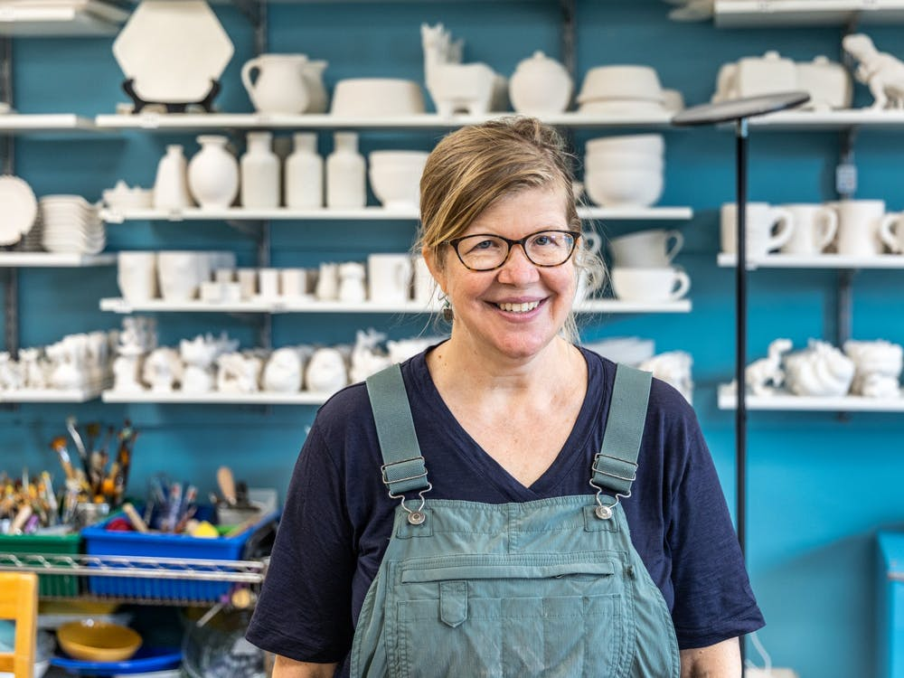 Susan Snyder, the Pottery House Studio owner, poses for a picture inside her business Sept. 4, 2021. Snyder opened the studio in Bloomington after studying pottery in Italy.