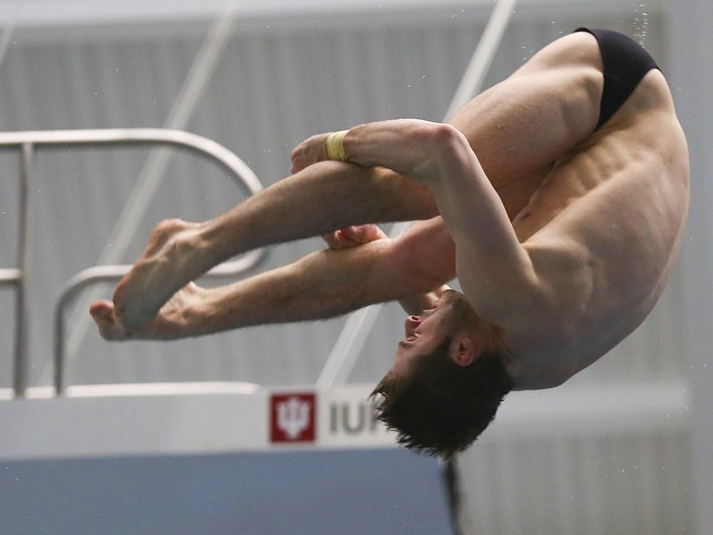 Then-junior Michael Hixon performs a back 2.5 somersault pike at the 2017 NCAA Swimming and Diving championships. Hixon and Andrew Capobianco won silver in 3-meter synchronized springboard diving.