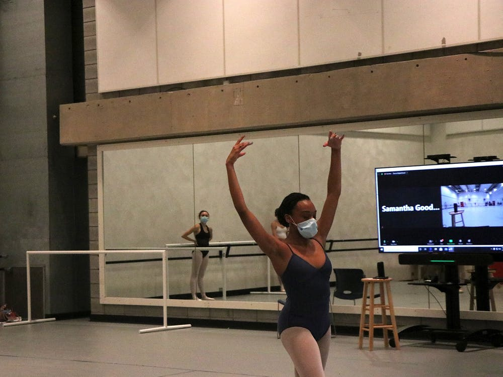 A ballet student rehearses in front of Sarah Wroth, chair of IU's ballet department. All IU ballet students are required to wear masks during in-person class.