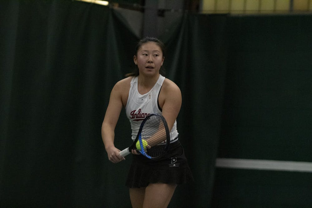 <p>Then-freshman Rose Hu prepares to serve March 1, 2020, at the IU Tennis Center. Hu won two of her three singles matches in the tournament.</p>