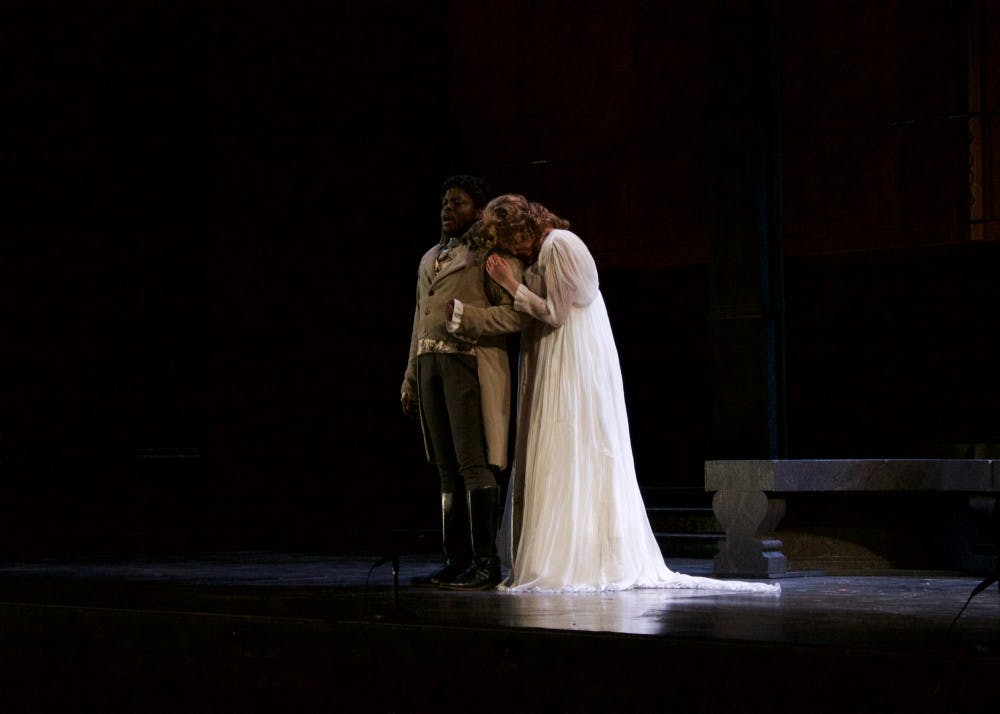 """<p>Kaitlyn Johnson, playing Donna Anna, embraces Leo Williams as Don Ottavio in """"Don Giovanni."""" The opera will be playing at the Musical Arts Center on September 15, 16, 22 and 23 at 7:30 p.m.</p>"""