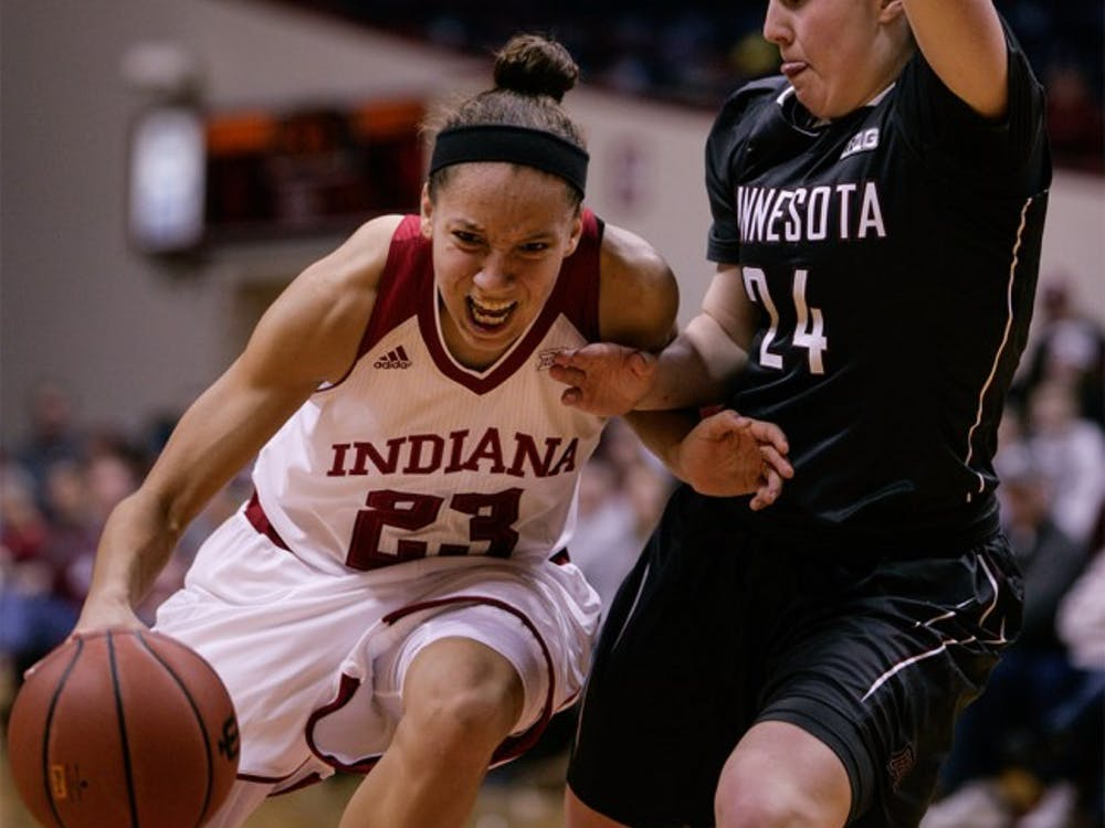 Junior guard Alexis Gassion dribbles the ball up the court against a Minnesota defender Feb. 18 at Assembly Hall.