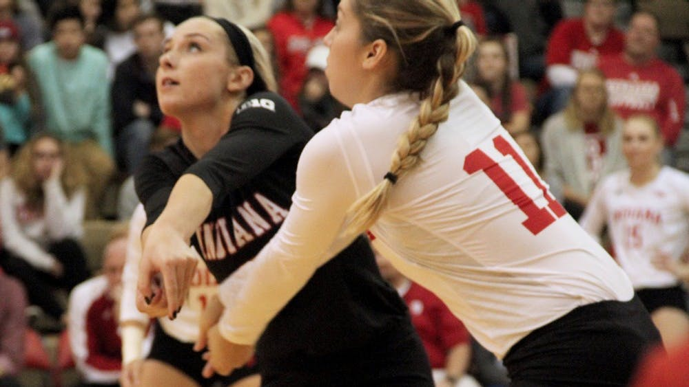 Taylor Lebo (left) and Allison Hammond receive the ball as IU competes against Nebraska on Saturday night.