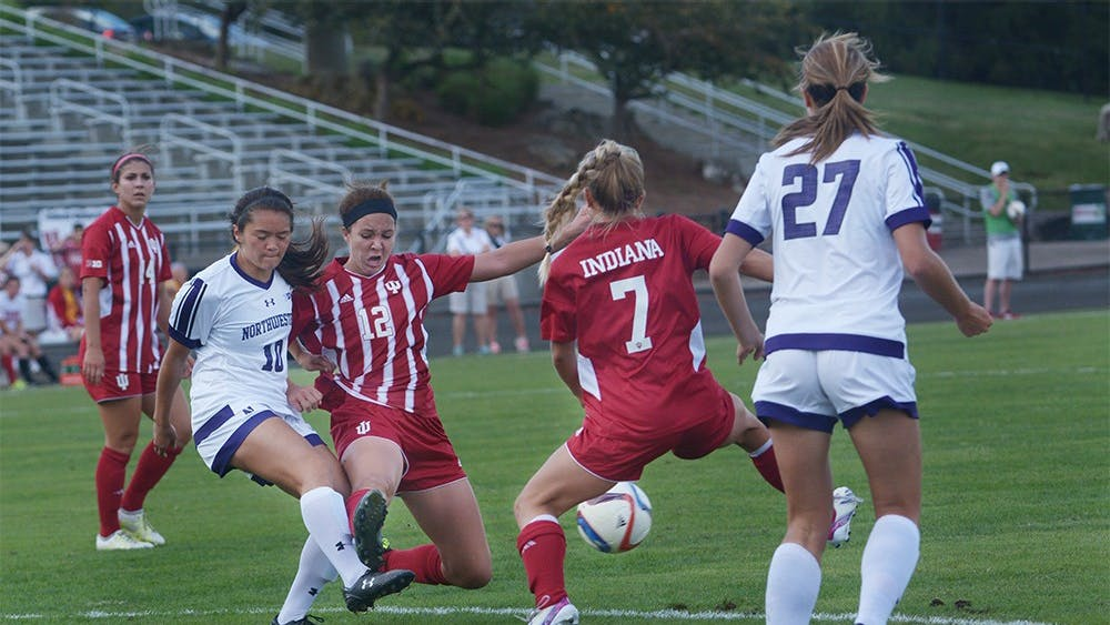 Freshman forward Hannah Johnson breaks through the Northwestern defense during the game on Sunday afternoon at Bill Armstrong Stadium. IU tied the game with Northwestern University 1-1.