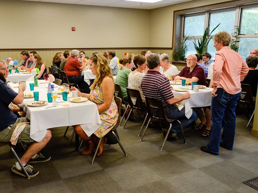"""Local residents eat brunch at """"Brunch upon a time"""" at the Community Kitchen of Monroe County on Sunday. The brunch was a fundraising event to support the Community Kitchen."""
